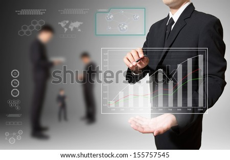 businessman analyze graph in hand - stock photo
