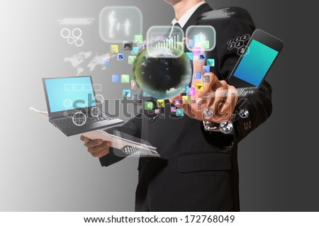 businessman analyze graph with technology - stock photo