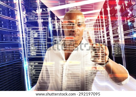 Businessman analyzes and touches a virtual database - stock photo