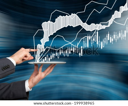 Businessman analyzes forex quotation graph by pointing out the specific segment.  - stock photo