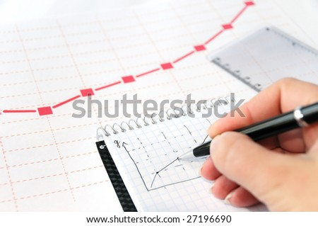 Businessman analyzing a diagram in his notepad