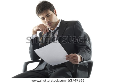 Businessman analyzing document - stock photo