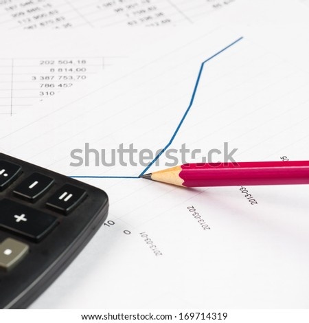 Businessman analyzing investment charts at his workplace  - stock photo