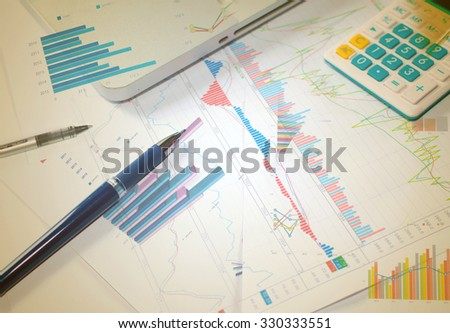 Businessman analyzing investment charts with laptop. - stock photo