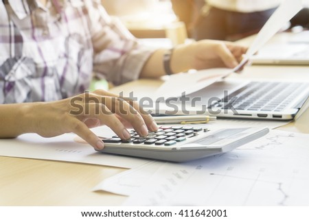 Businessman analyzing investment charts with laptop. Accounting and technology in office. selective focus, vintage color - stock photo