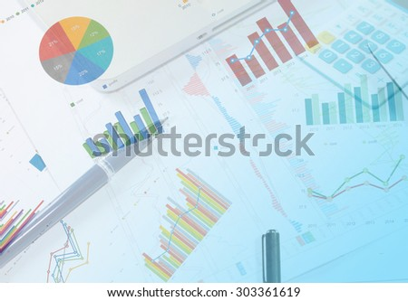 Businessman analyzing investment charts with laptop.business Concept