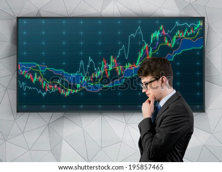 Businessman analyzing news, graph and quotes on screen  - stock photo