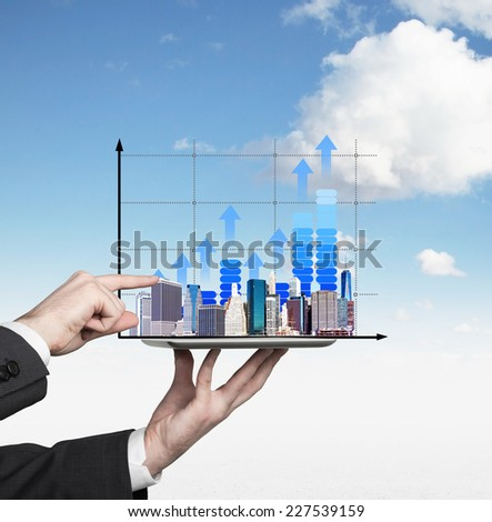 Businessman analyzing real estate market  - stock photo