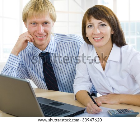 businessman and a businesswoman working together - stock photo