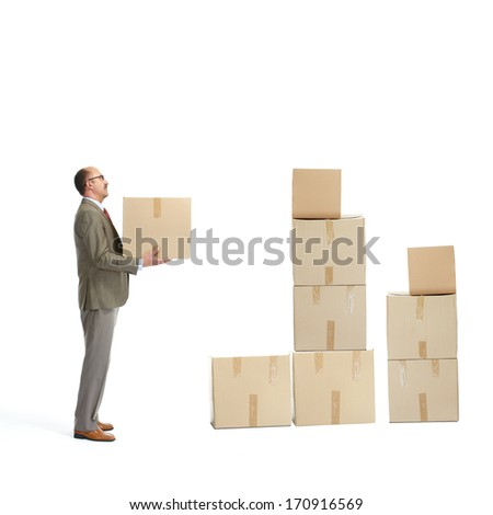 Businessman and a cardboard boxs on a white background - stock photo