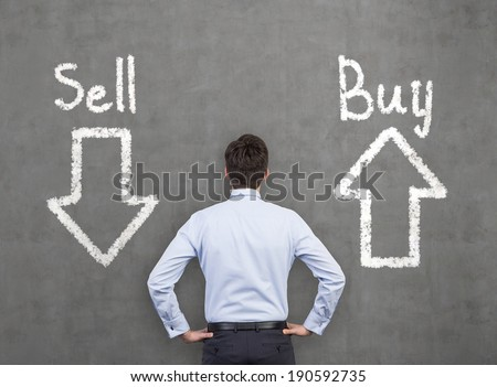 Businessman and a choice 'sell or buy' - stock photo