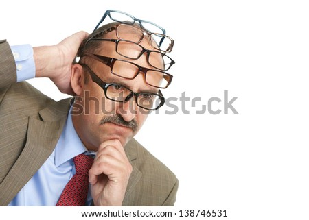Businessman and a lot of spectacles on a white background