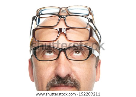 Businessman and a lot of spectacles on a white background - stock photo