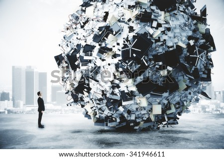 Businessman and big heap of office stuff at city background