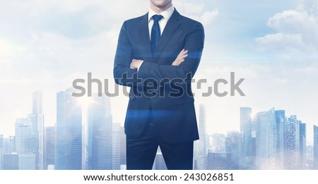 Businessman and blurred city on horizon