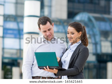 Businessman and bsuinesswoman working outdoor  - stock photo