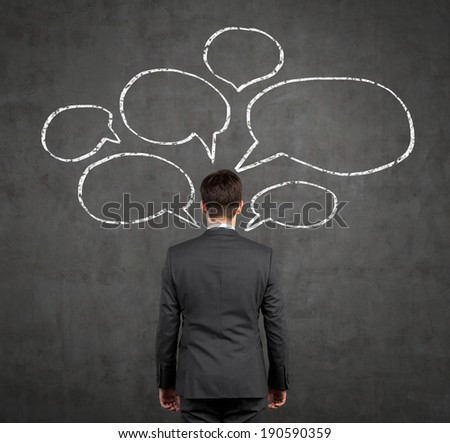 Businessman and bubble thoughts - stock photo