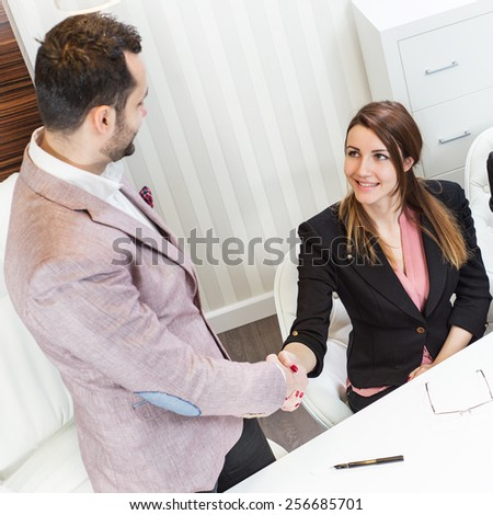 Businessman and business woman have just completed the signing of the contract. Office. Young business people.  - stock photo