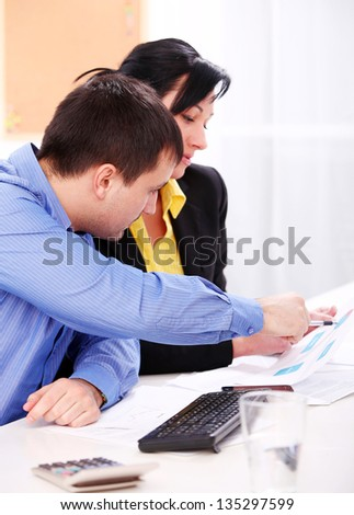 Businessman and businesswoman are working at office