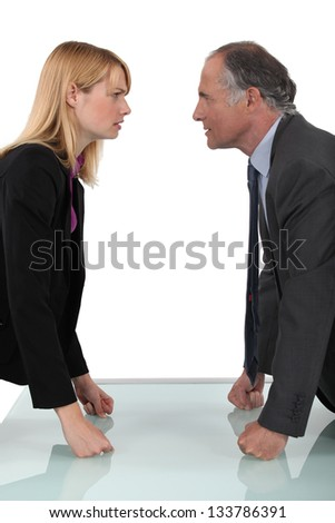 businessman and businesswoman having a quarrel - stock photo