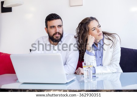 Businessman And Businesswoman Meeting In Coffee Shop. Business couple working on computer,shallow depth of field - stock photo