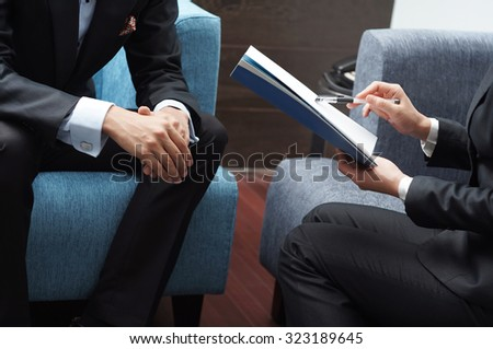 Businessman and Businesswoman Meeting on Sales Pitch - stock photo