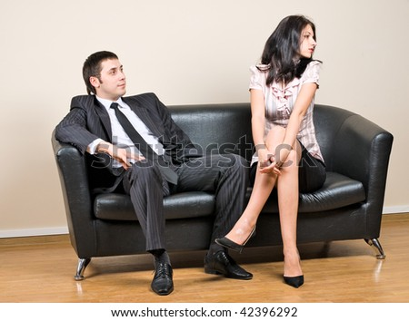 Businessman and businesswoman on sofa