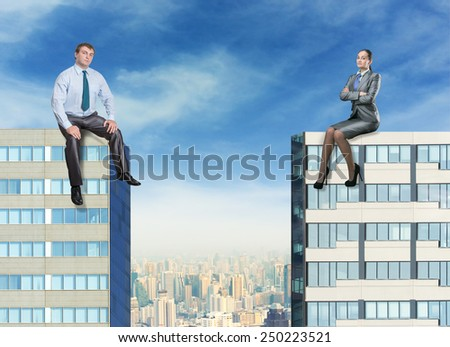 Businessman and businesswoman on the buildings - stock photo