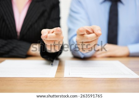 businessman and businesswoman pointing with fingers to you. Staffing and recruitment concept - stock photo