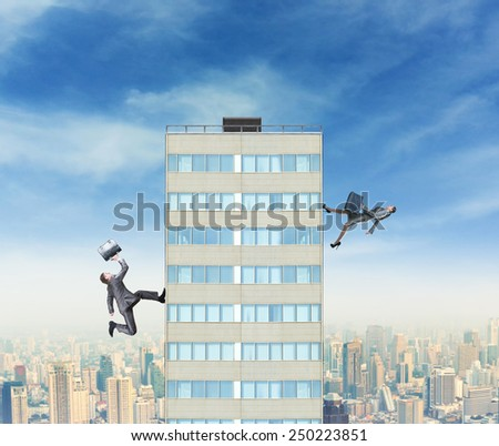 Businessman and businesswoman running to the top - stock photo