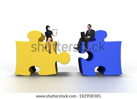 businessman and businesswoman sitting on big color puzzle - stock photo