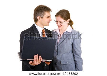 businessman and businesswoman together with notebook - stock photo