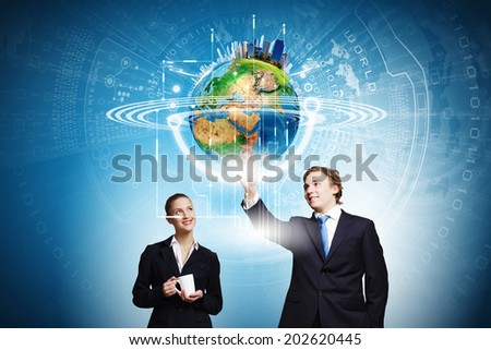 Businessman and businesswoman touching icon of digital screen. Elements of this image are furnished by NASA - stock photo