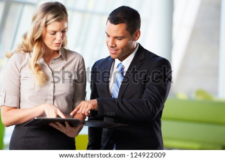 Businessman And Businesswomen Having Informal Meeting In Office - stock photo