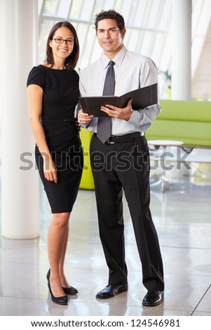 Businessman And Businesswomen Having Meeting In Office - stock photo