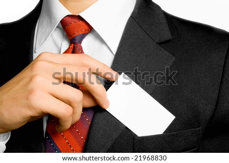 Businessman and card in coat. Shallow DOF. - stock photo