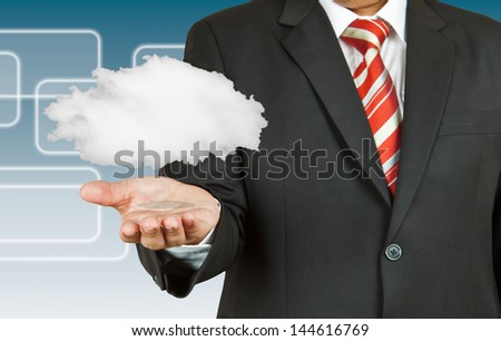 Businessman and cloud computing - stock photo