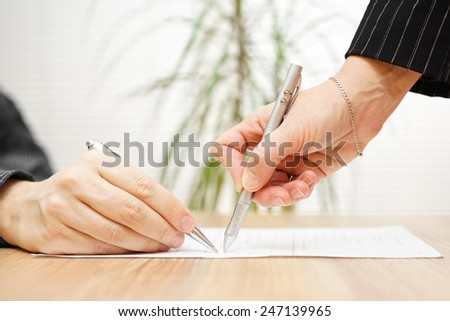 businessman and consultant discussing over  contract - stock photo