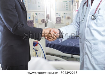 Businessman and doctor shaking hand's for some agreement - stock photo