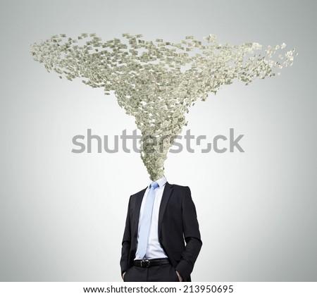 Businessman and Dollar Tornado Head. - stock photo