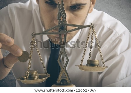 Businessman and earning balance concept - stock photo