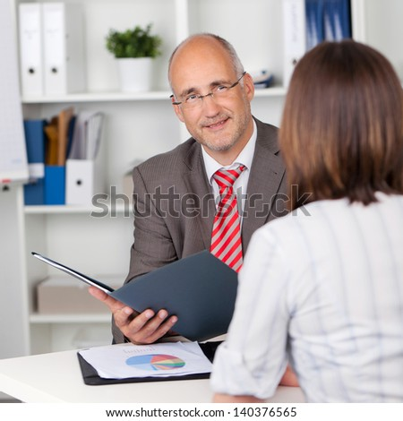 businessman and female candidate in personal interview - stock photo
