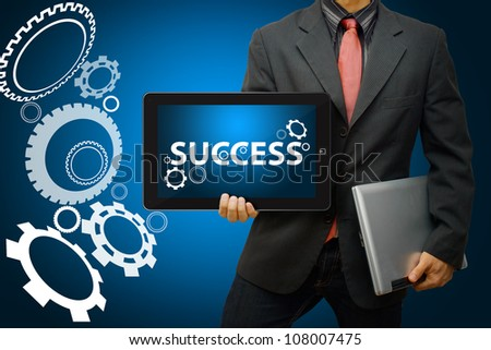 Businessman and gear to success - stock photo