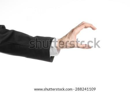 Businessman and gesture topic: a man in a black suit and white shirt showing hand gesture on an isolated white background in studio