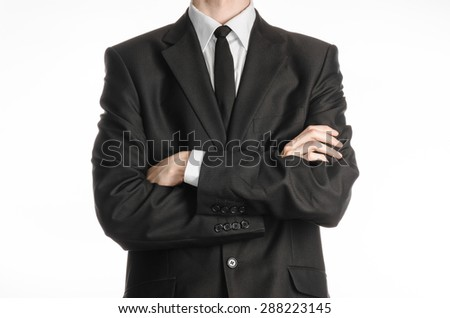 Businessman and gesture topic: a man in a black suit with a tie folded his hands in front of him isolated on a white background in studio