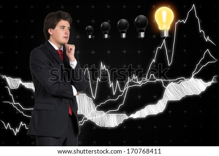 Businessman and graph - stock photo