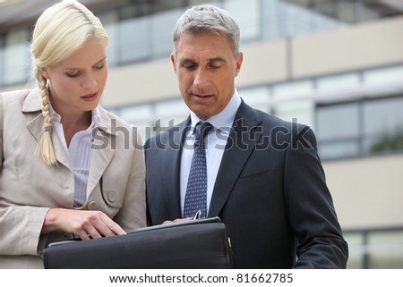 businessman and his assistant working on project - stock photo