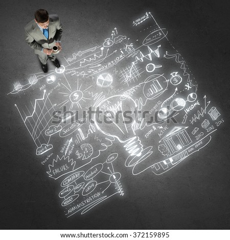 Businessman and his business strategy - stock photo