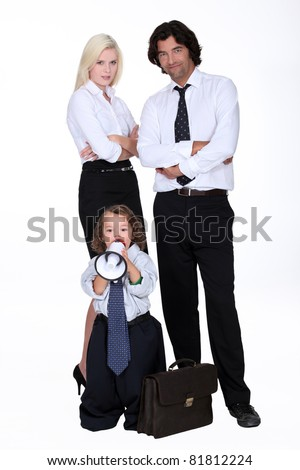 Businessman and his smart family - stock photo