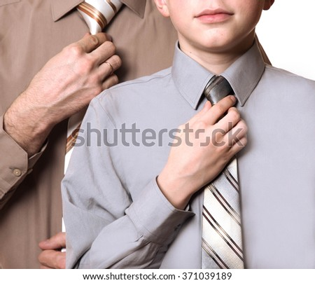 businessman and his son is mending ties isolated on white background - stock photo